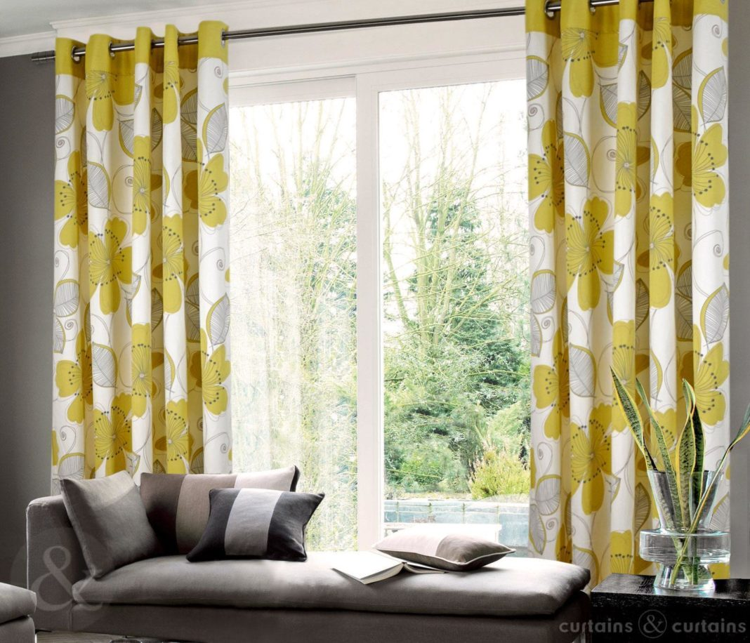 Grommet-top-yellow-and-gray-floral-curtain-in-living-room